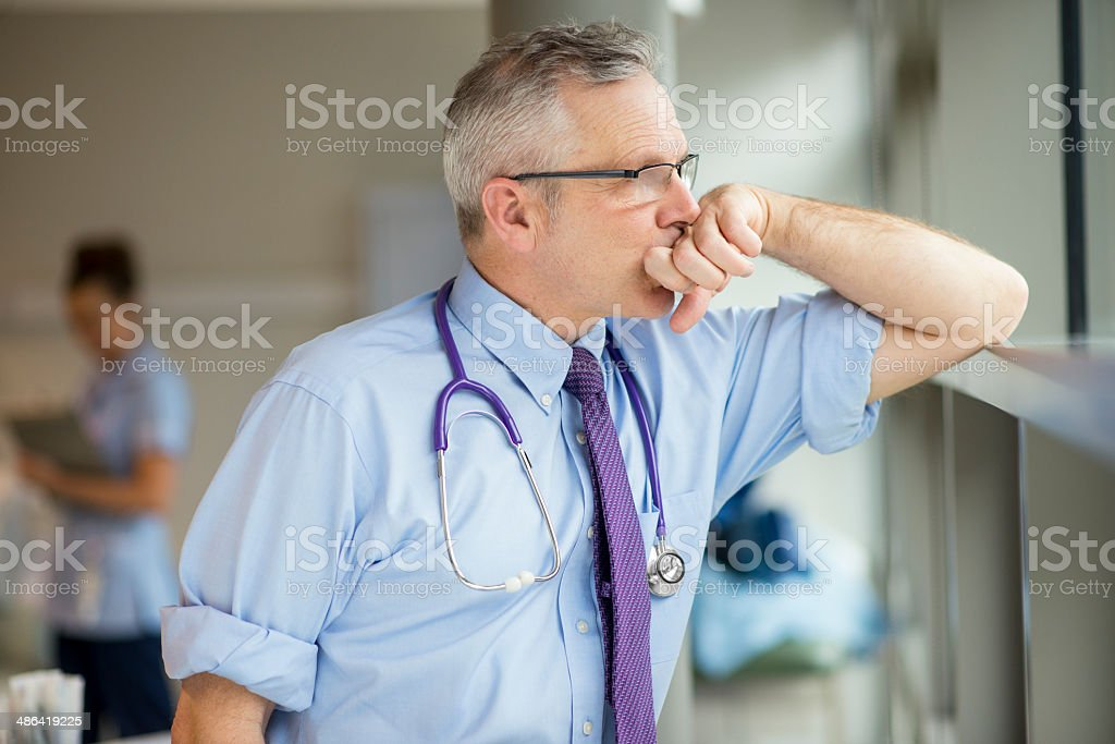 exhausted doctor stock photo