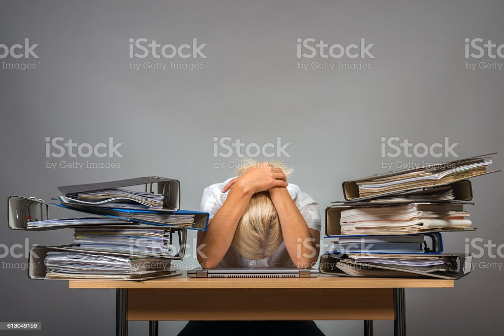 exhausted in office stock photo