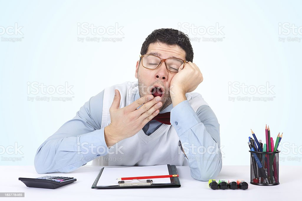Exhausted nerdy businessman yawning at work in his office royalty-free stock photo