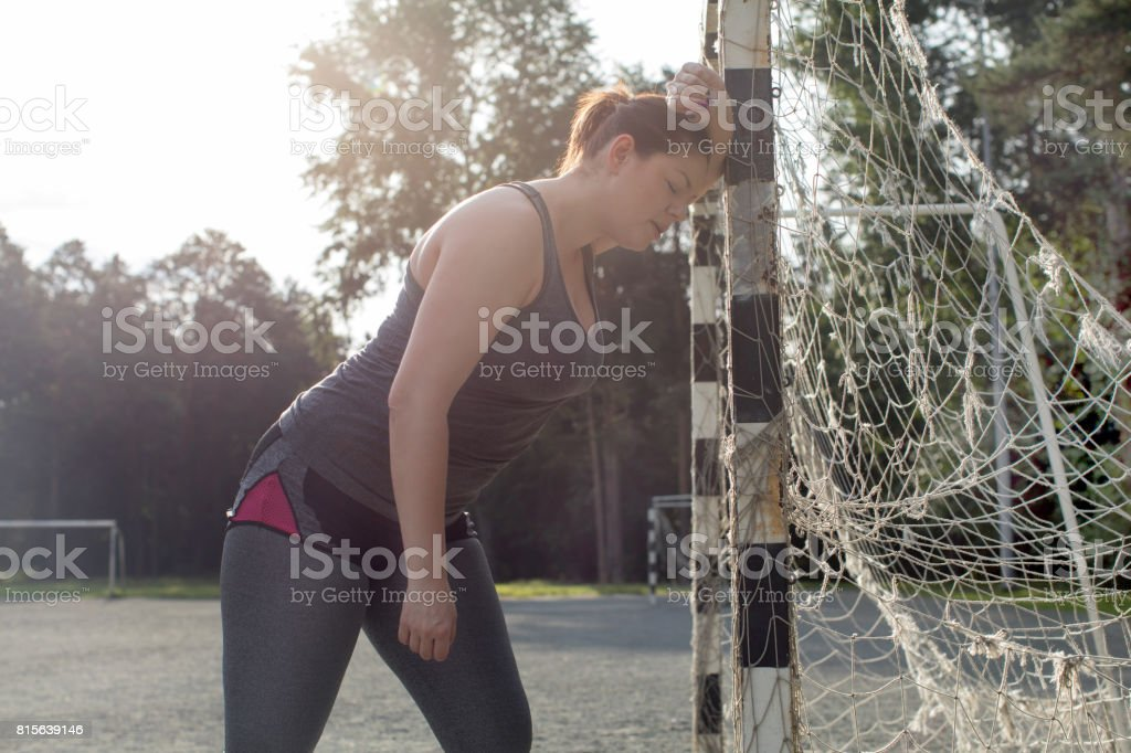 Exhausted overweight woman after a long workout stock photo