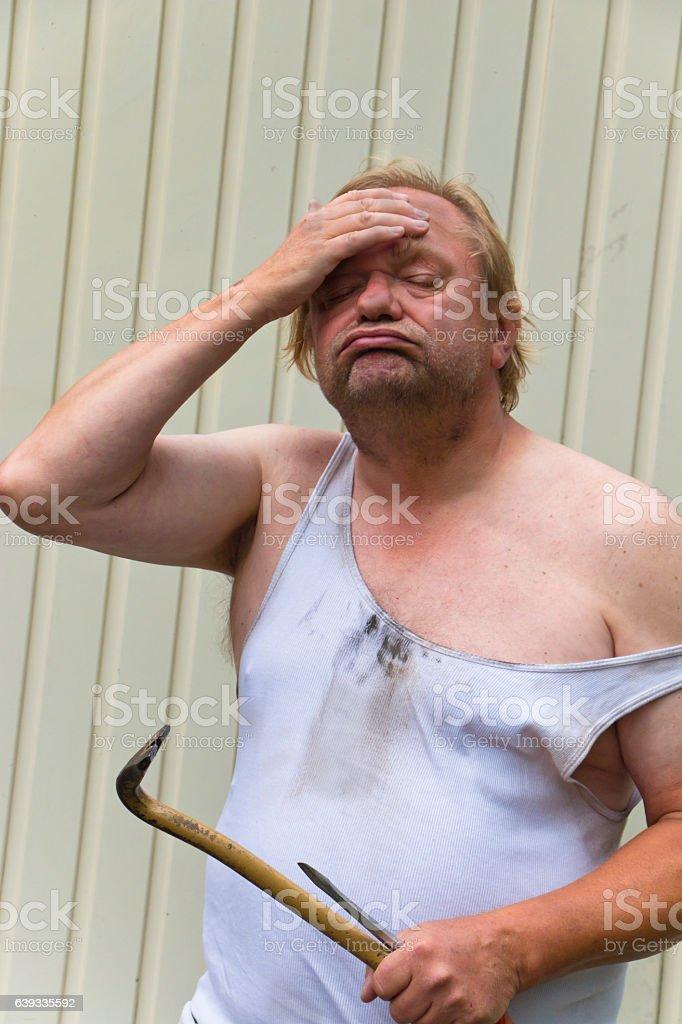 Exhausted Repairman stock photo