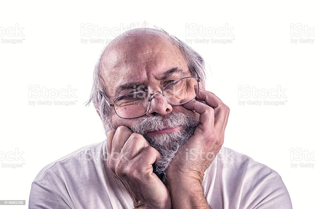 Exhausted Senior Adult Man Struggling To Stay Awake stock photo