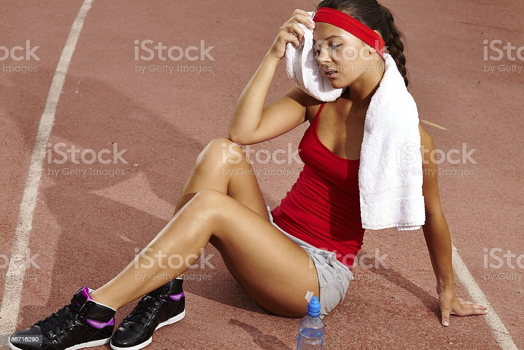 Exhausted sportswoman royalty-free stock photo