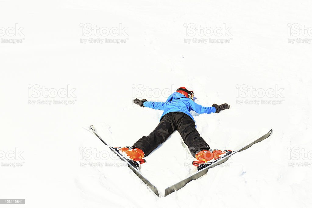 exhausted teenage girl lying in the snow royalty-free stock photo