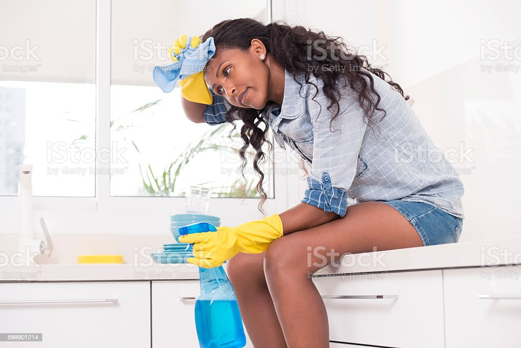 Exhausted woman after cleaning. stock photo