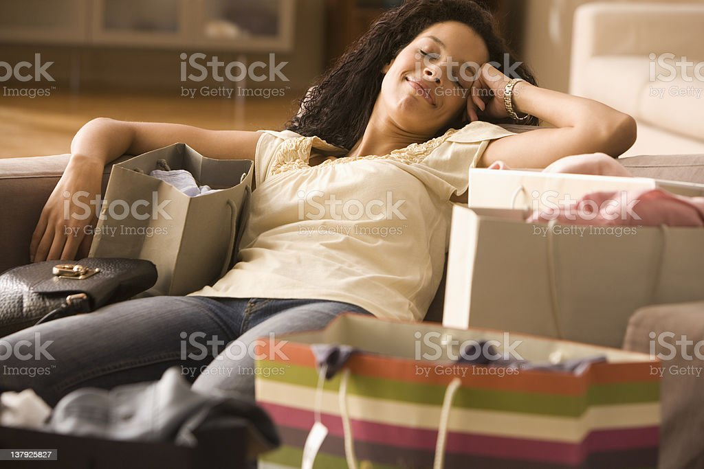 Exhausted woman after shopping royalty-free stock photo