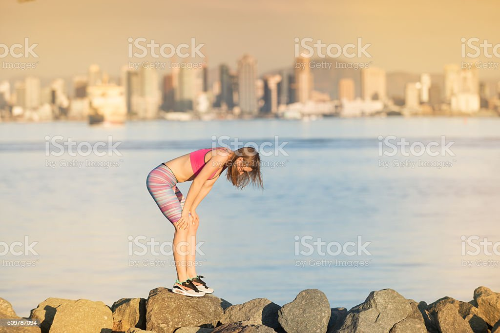 Exhausted Women After Run With San Diego Skyline Behind stock photo