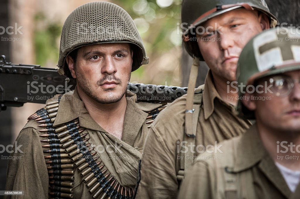 Exhausted WWII Soldiers stock photo