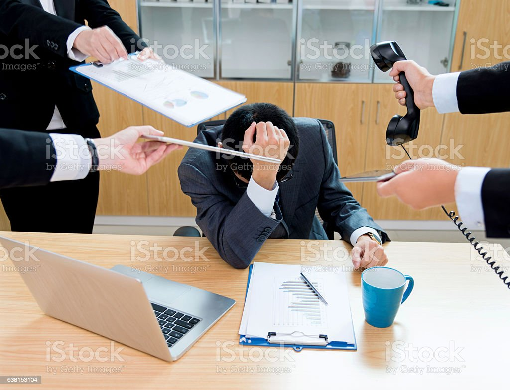 Exhaustion with too many tasks stock photo