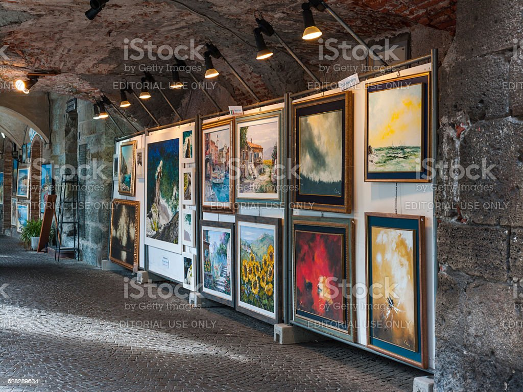 Exhibition of amateur paintings under an arcade stock photo