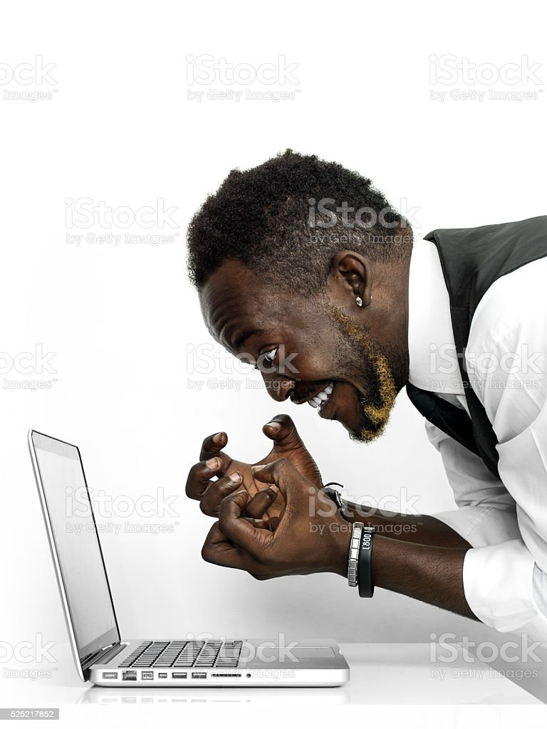 Exhilarated african businessman portrait receiving good news stock photo