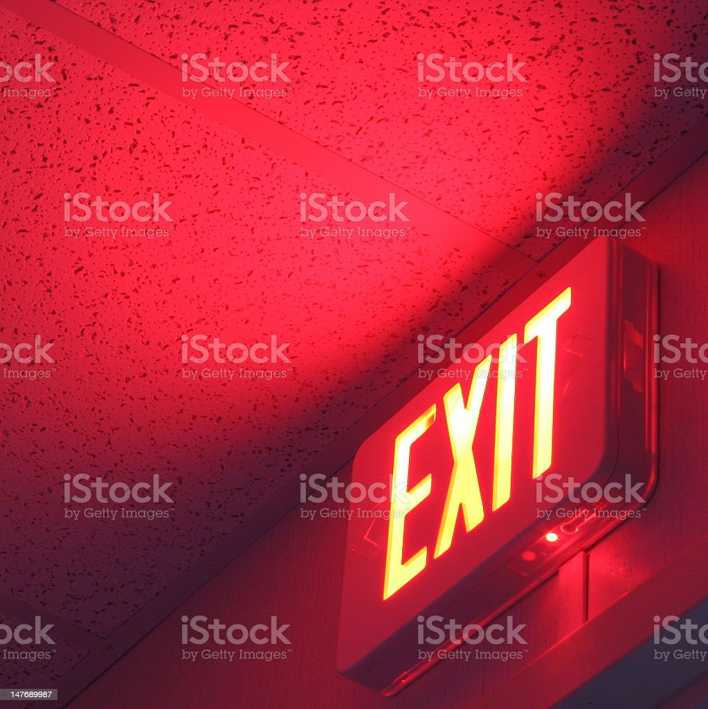 A exist sign lit up over a door stock photo