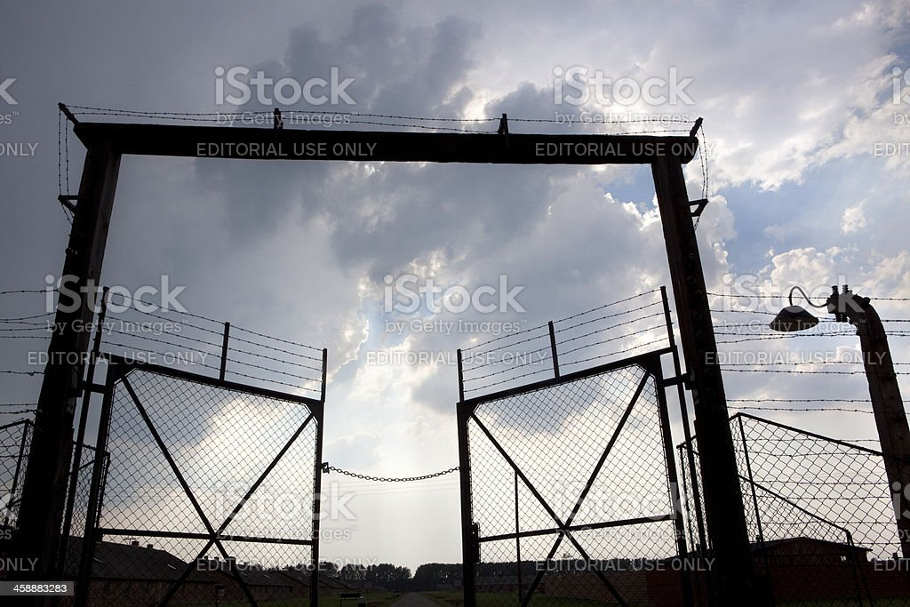 Exit door and barbed wire fence. Auschwitz camp royalty-free stock photo