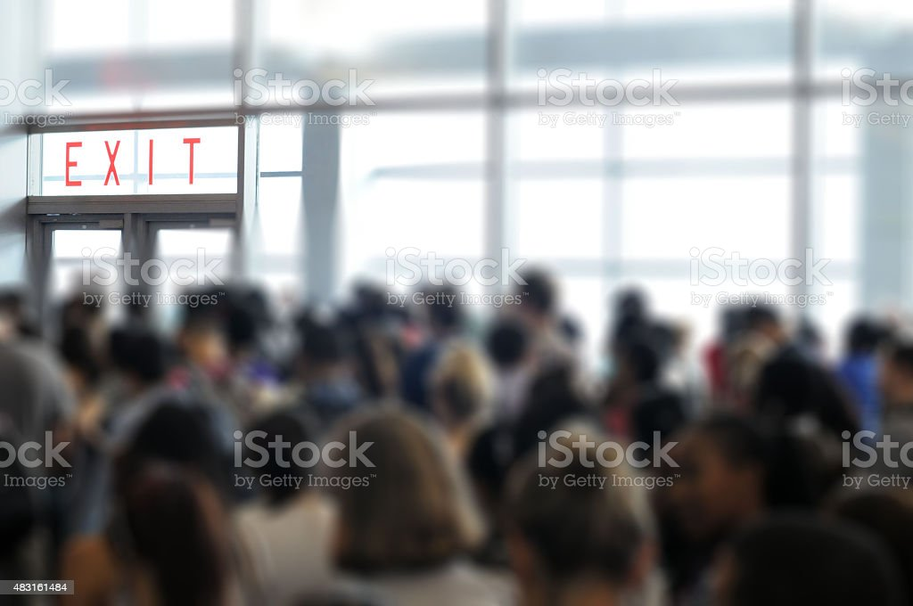 Exit doors with crowd and blur stock photo