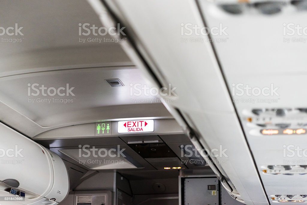 Exit Sign Inside The Passenger Aircraft stock photo
