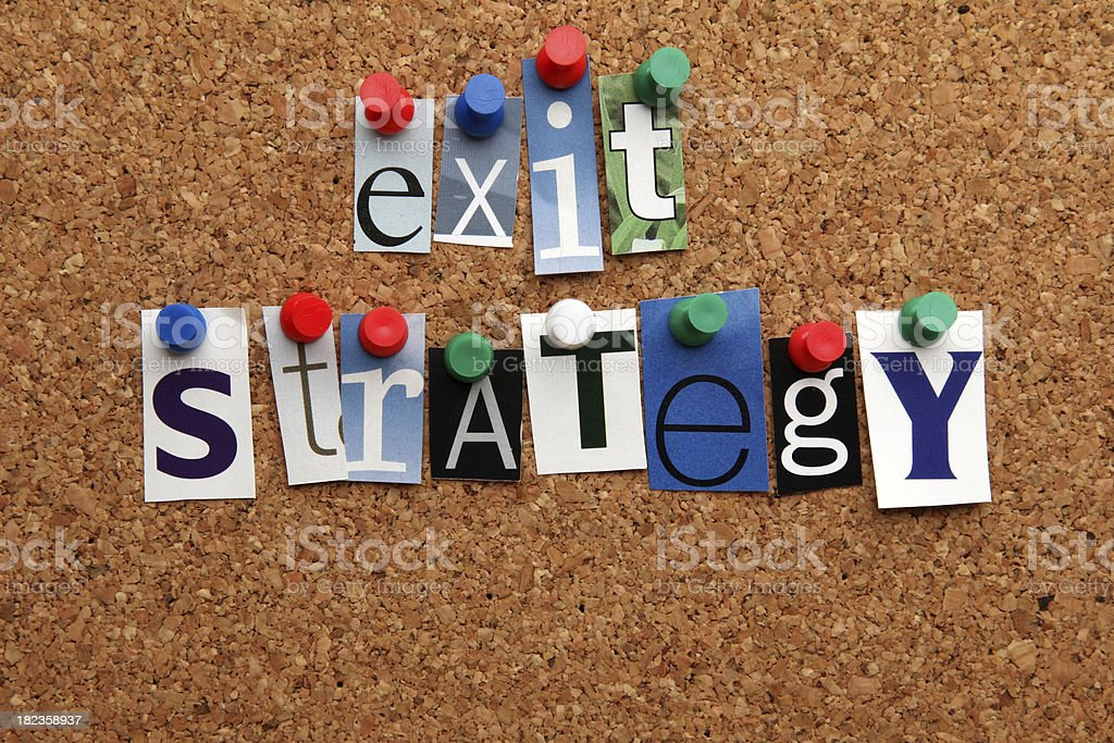 Exit strategy pinned on noticeboard royalty-free stock photo