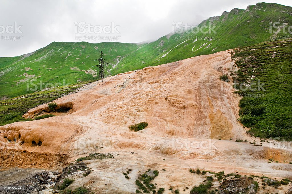 Exit travertine rock on the surface of the earth. Georgia stock photo