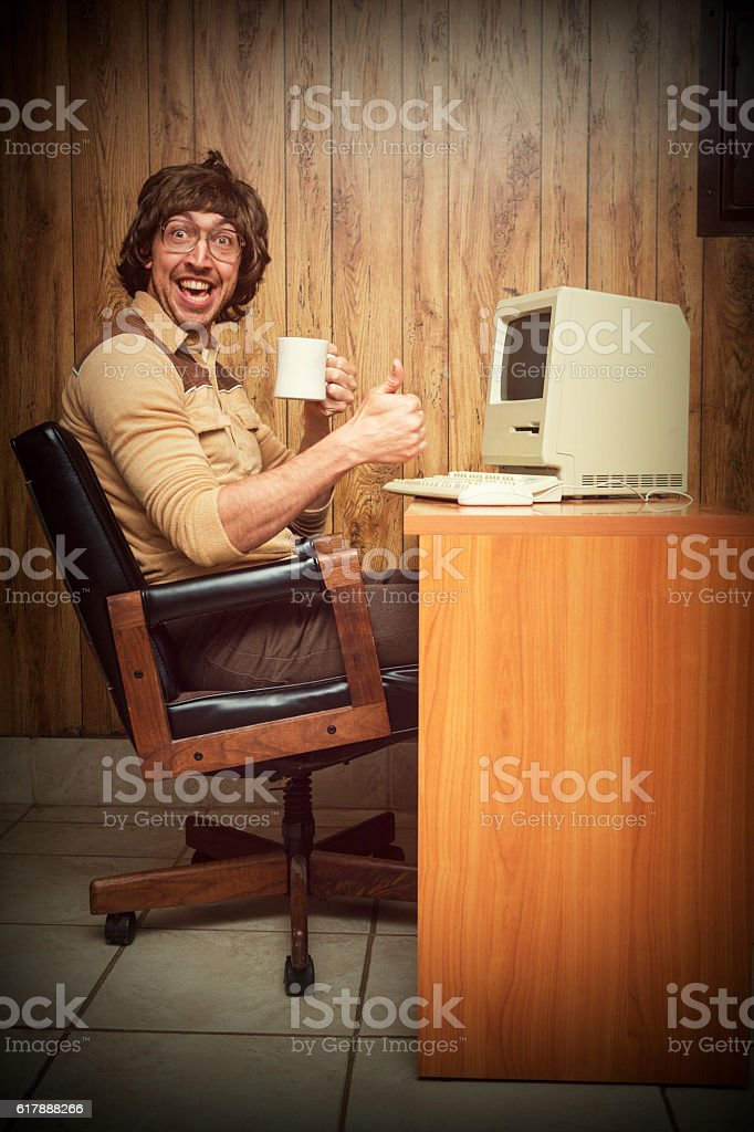 Exited Computer dorky nerd worker at desk stock photo
