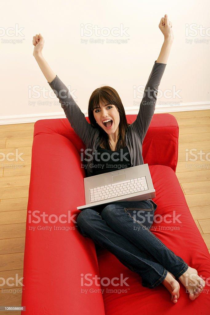 Exited female using laptop royalty-free stock photo