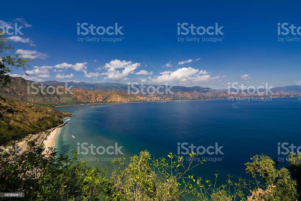 Exotic beach and deep blue sea stock photo