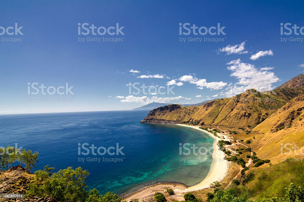 Exotic beach and deep blue sea stock photo