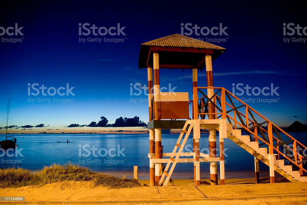 exotic beach scenery with lifeguard tower at night stock photo
