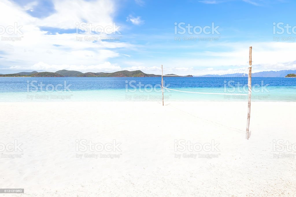 Exotic beach volleyball court stock photo