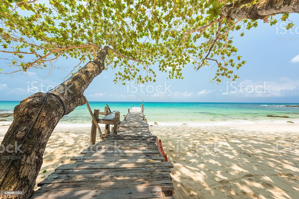 Exotic beach with wooden bridge at Koh Kood island, Thailand stock photo