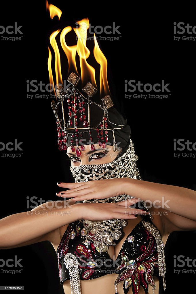 Exotic belly dancer wearing a hijab and fire headdress royalty-free stock photo