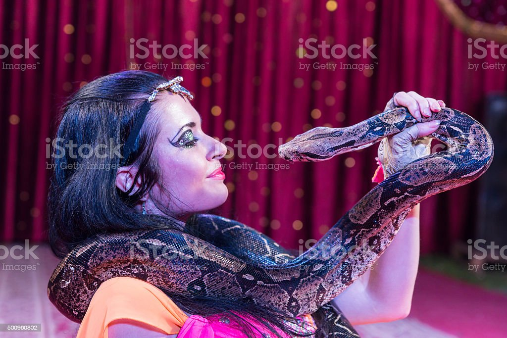 Exotic Dancer with Snake on Stage stock photo