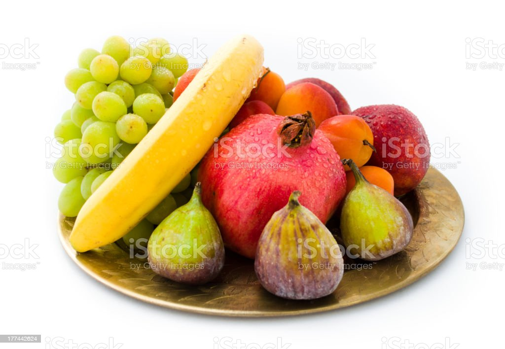 Exotic fruit plate isolated against white background royalty-free stock photo