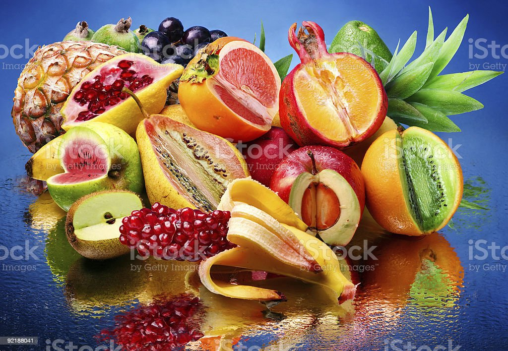 Exotic fruits in a pile on blue background royalty-free stock photo