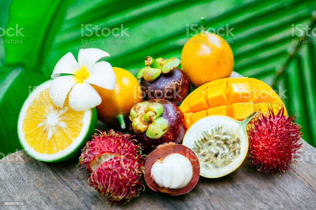 Exotic fruits on the wooden table stock photo