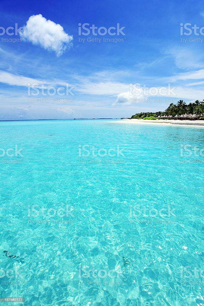 Exotic paradise with blue sea and island in the Maldives. royalty-free stock photo