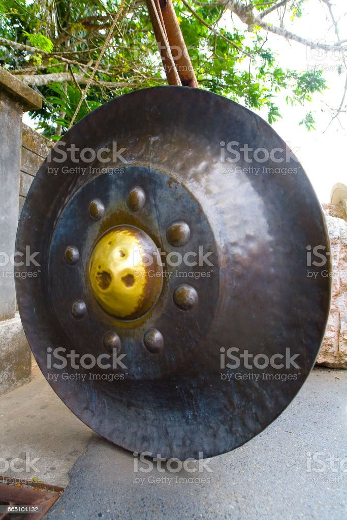 Exotic round metallic Thai gong. Phuket. Thailand. stock photo