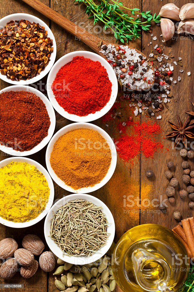 Exotic spices and herbs on rustic wood table stock photo