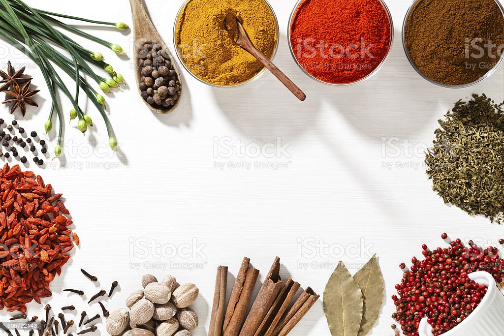 Exotic spices border with copy space shot from above stock photo