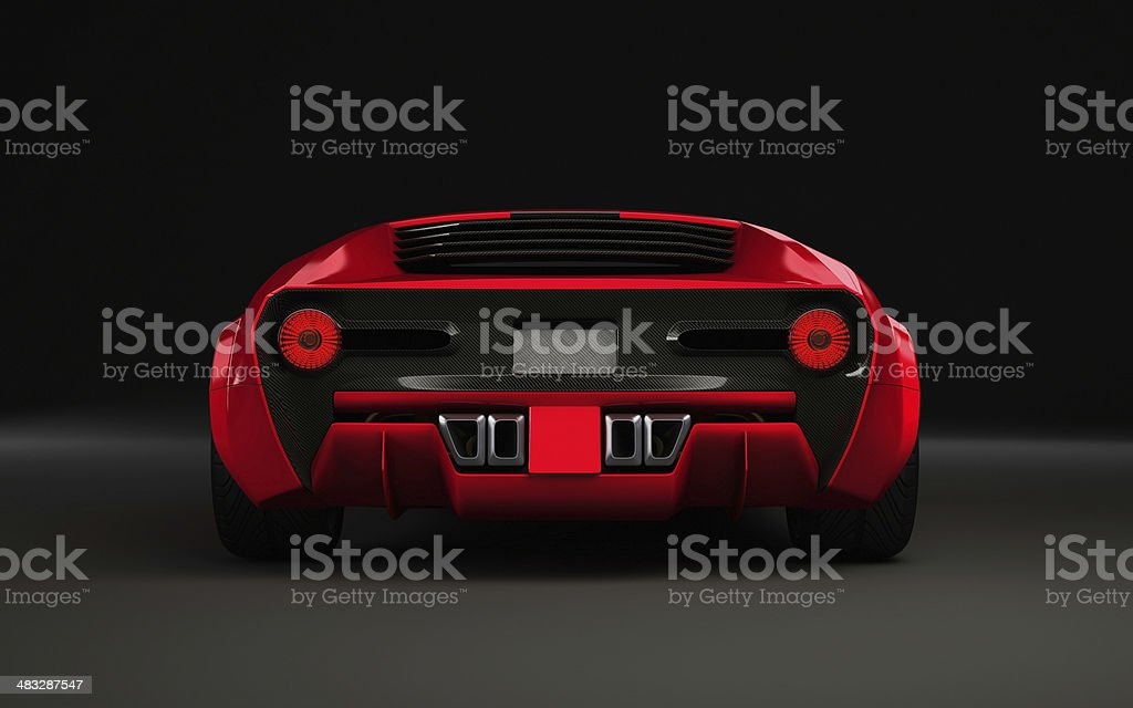 Exotic sportscar in red on dark background from behind stock photo
