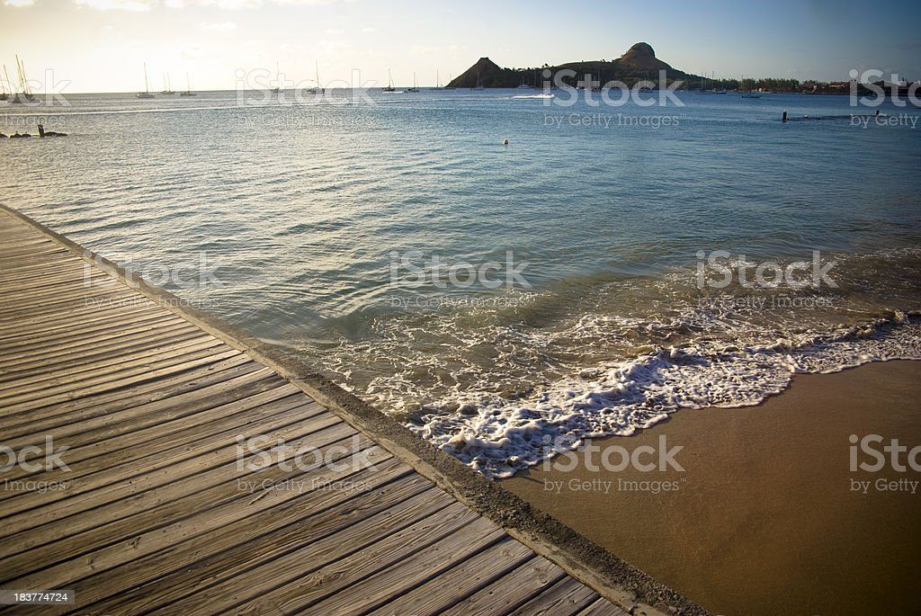 exotic sunset scene with beach and jetty stock photo