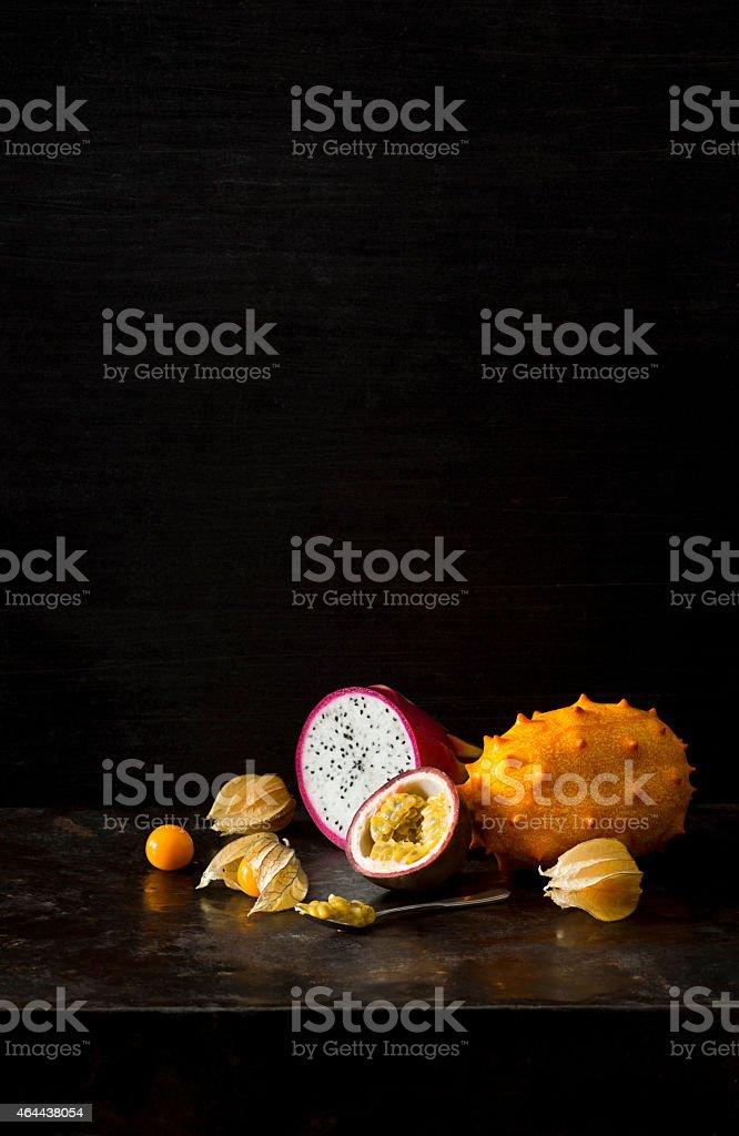 Exotic Tropical Fruit Still Life with Passionfruit Pitaya Physalis Melano stock photo