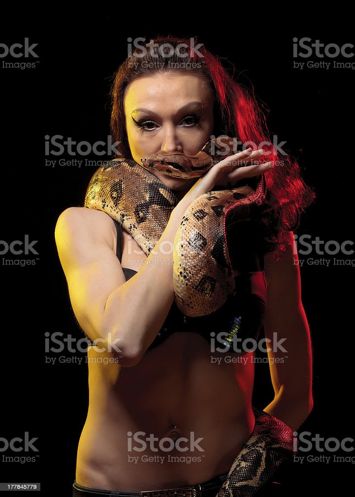 Exotic Woman with a Boa royalty-free stock photo