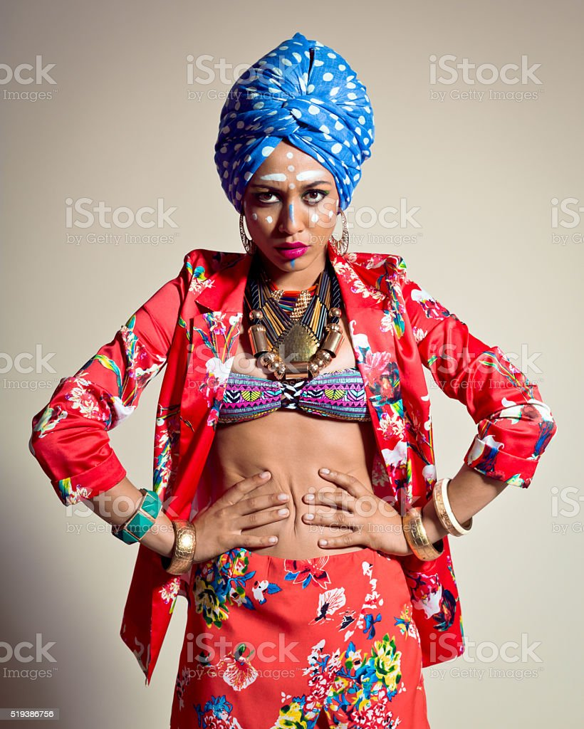 Exotic Young Woman wearing blue turban stock photo