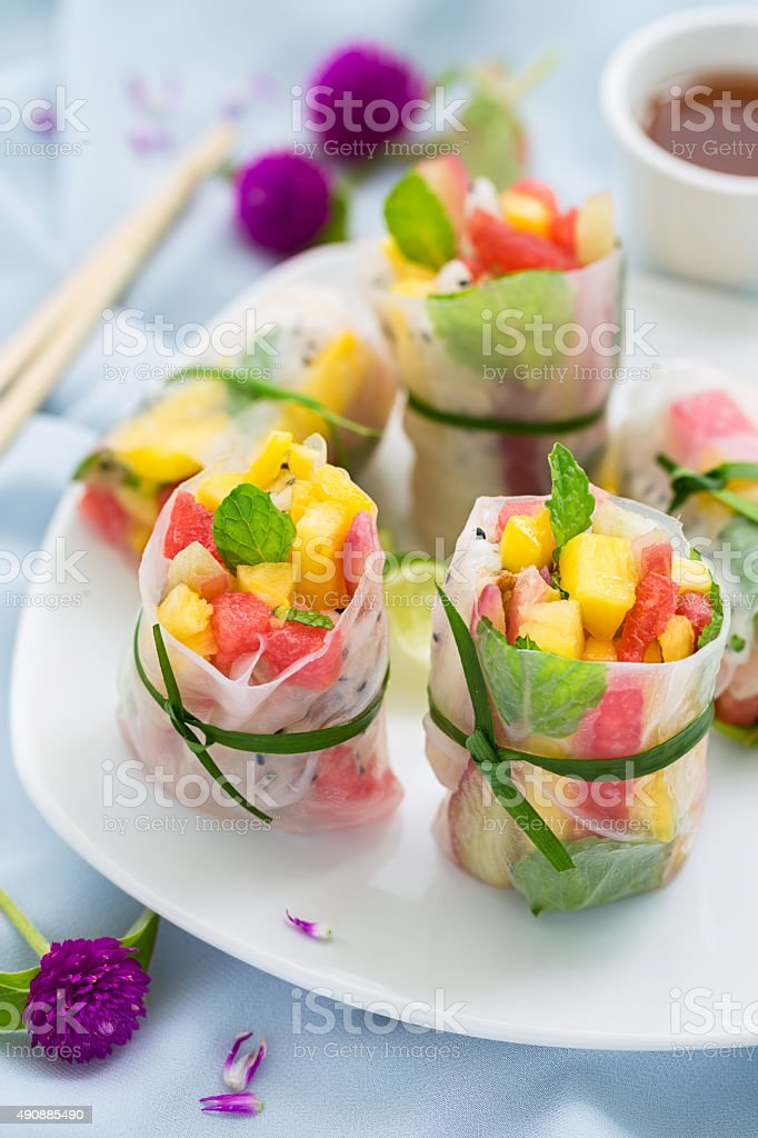 exotics fruits spring rolls stock photo