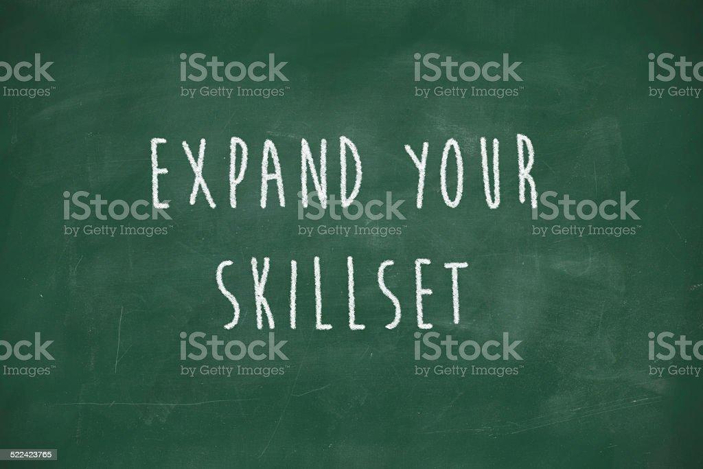 Expand your skillset handwritten on blackboard stock photo