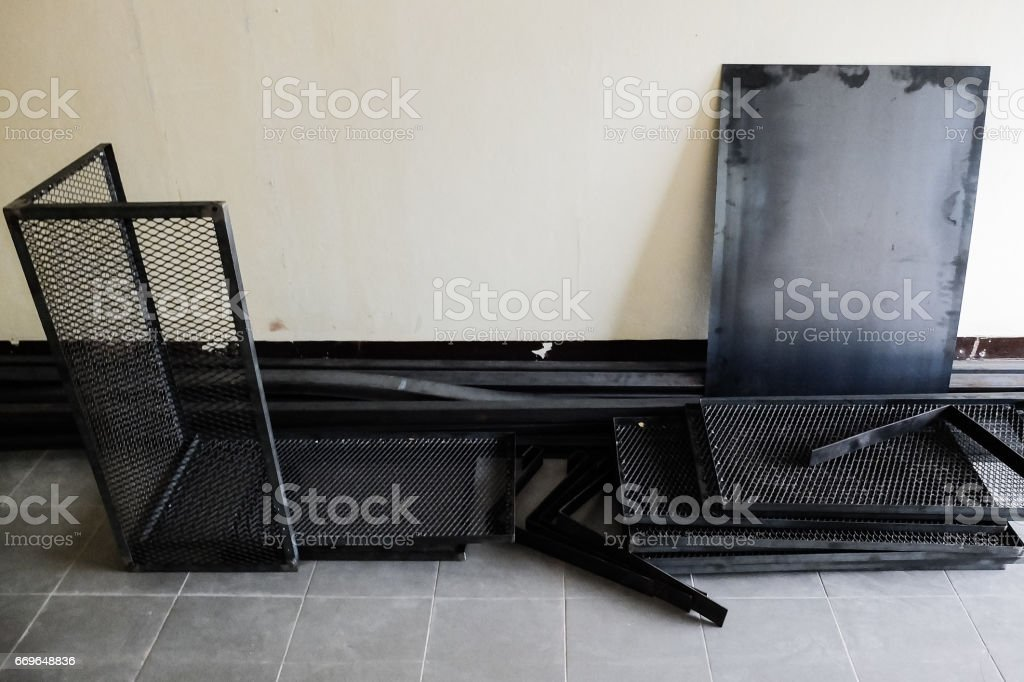 Expanded metal and steel rod on the floor stock photo