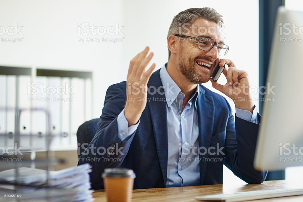 Expanding his empire using technological resources stock photo