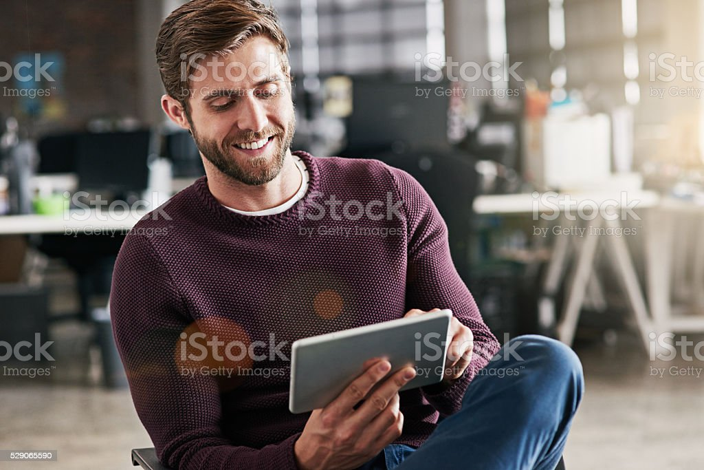 Expanding his new business using online resources stock photo