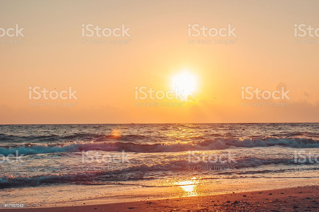 Expanse of the sea against the sunset sky. Beautiful seascape royalty-free stock photo