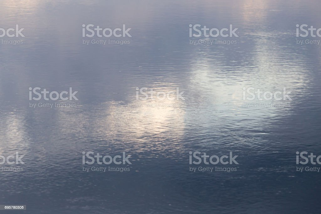 expanse of water in the lake as a backdrop stock photo
