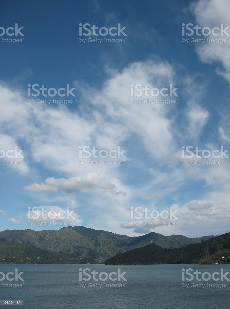 Expansive view of white clouds above windswept water royalty-free stock photo
